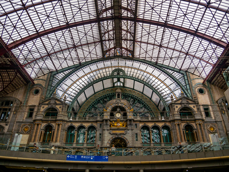 Antwerp, Belgium - August 25, 2018 :Symmetrical composition of the main hall of the famous Antwerp Railway train station, also known as the cathedral amongst stations