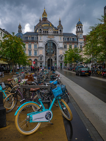 Antwerp, Belgium - August 25, 2018 : Bicycles parked outside Central Train Station of Antwerp Editorial