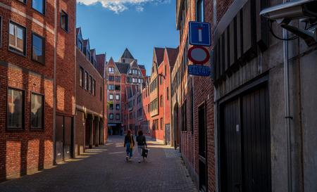 Antwerp, Belgium - August 25, 2018 : People walking in streets of Antwerp close to Market Square Stock Photo - 120227953
