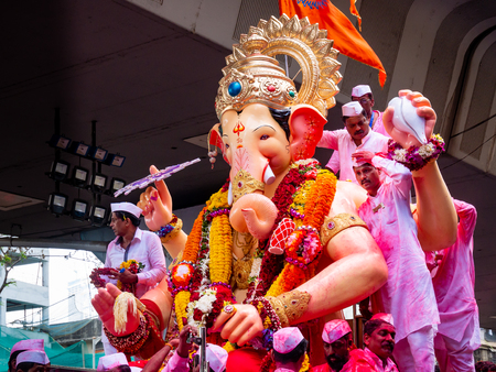 Mumbai, India - September 23,2018: Thousands of devotees bid adieu to Lord Ganesha in Mumbai during Ganesh Visarjan which marks the end of the ten-day-long Ganesh Chaturthi festival. Stock Photo - 120228022