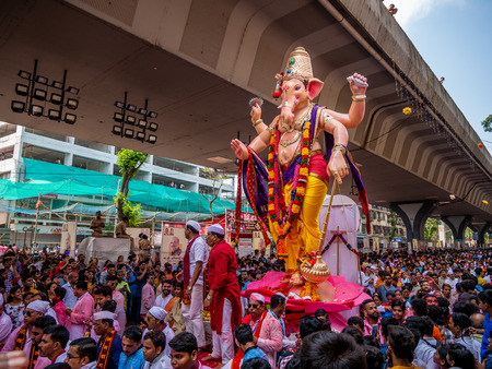 Mumbai, India - September 23,2018: Thousands of devotees bid adieu to Lord Ganesha in Mumbai during Ganesh Visarjan which marks the end of the ten-day-long Ganesh Chaturthi festival. Stock Photo - 120228083