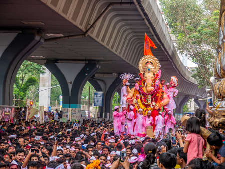 Mumbai, India - September 23,2018: Thousands of devotees bid adieu to Lord Ganesha in Mumbai during Ganesh Visarjan which marks the end of the ten-day-long Ganesh Chaturthi festival. Stock Photo - 120228090