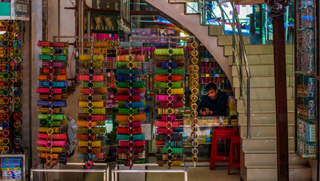 Hyderabad, India - June 17, 2019 : Shopkeeper selling bangles, Laad Bazaar or Choodi Bazaar is a very old market popular for bangles located near Charminar.