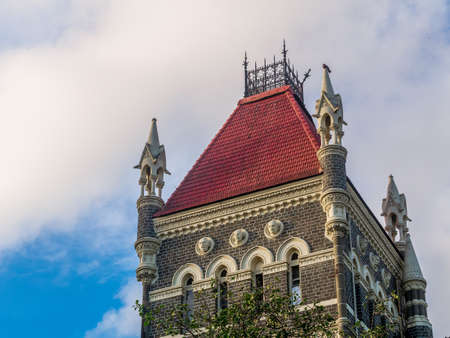 Mumbai, India - June 30, 2019 : Mumbai cityscape. Colonial architechture in Mumbai 에디토리얼