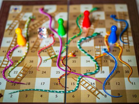 Closeup image of a Snakes and Ladders game
