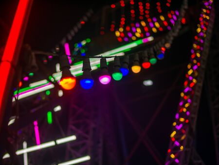 Colourful lights at amusement park in night