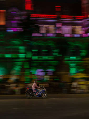 Mumbai, India - January 26, 2020 : Unidentifed man riding a bike with pillion near CST station at south Mumbai