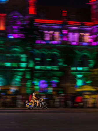 Mumbai, India - January 26, 2020 : Mumbai policeman riding a police bike near CST station at south Mumbai