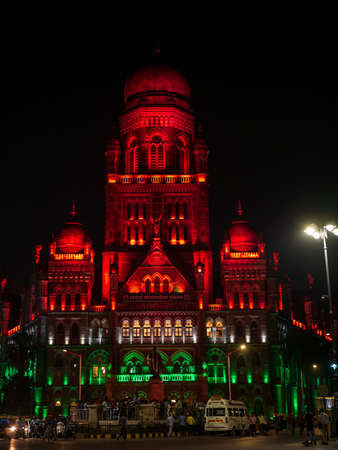 Mumbai, India - January 26, 2020 : BMC municipal building a UNESCO World Heritage Site in Mumbai decorated/illuminated in India flag color lights 에디토리얼