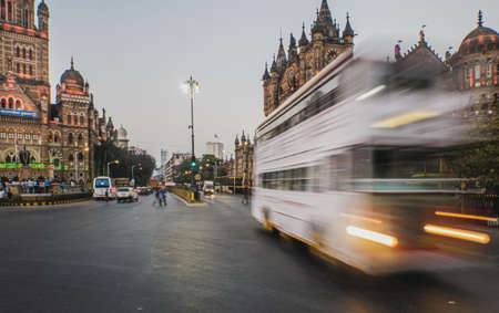 Mumbai, India - January 26, 2020 : A moving double decker BEST bus near CST station in south Mumbai 에디토리얼