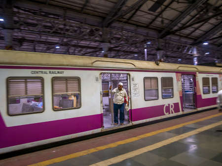 Mumbai, India - January 26, 2020: Deserted platform and local trains during lockdown in Mumbai due to corona pandemic