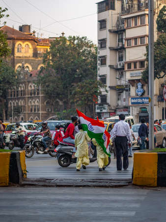 Mumbai, India - January 26, 2020 : Kids carrying indian tricolor flag on a streets of Mumbai on republic day of india 에디토리얼