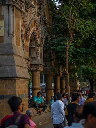 Mumbai, India - January 26, 2020 : Unidentified indian man watching mobile phone on a busy street near CST station