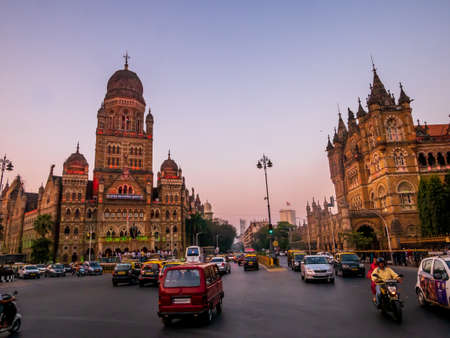 Mumbai, India - January 26, 2020 : Running taxis near BMC municipal building a UNESCO World Heritage Site in Mumbai