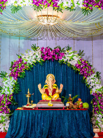 Lord Ganesha decorated with orchid flowers