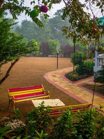Colourful stripy benches in a garden