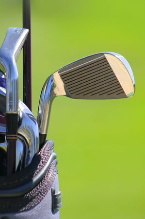 shallow depth of feald of golf clubs with green background