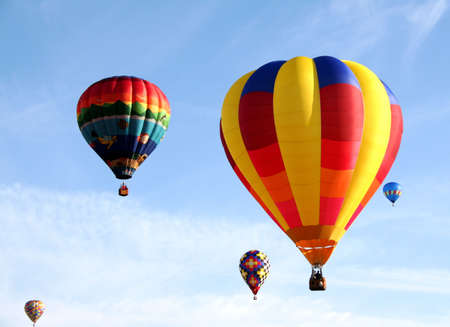 aloft: Colorful balloons flying in the sky  Stock Photo