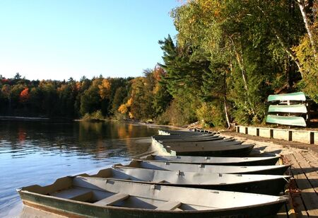 Boats in a small lake during autumn time photo