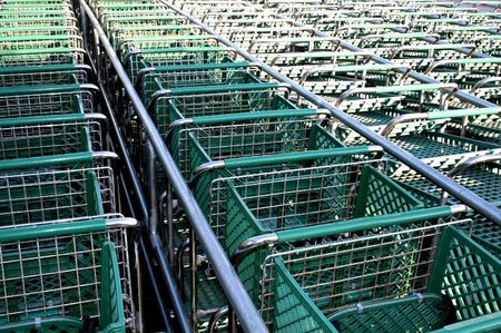 shopping binge: green colour shopping carts in a row Stock Photo