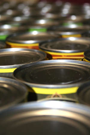 producing: Food Cans For Charity Stock Photo