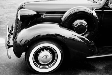black classic car is going on the road Stock Photo - 1349811