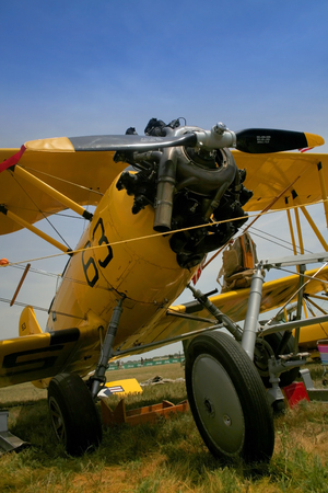 fixed wing aircraft: A vintage airplane showing propeller and front wheel