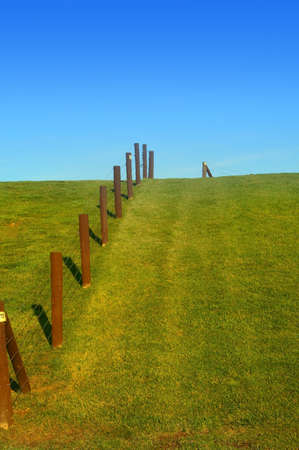 untidy: Fence in a park with blue sky back ground
