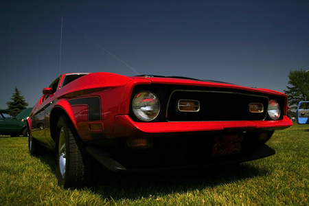 Agressive wide angle shot of red old muscle car