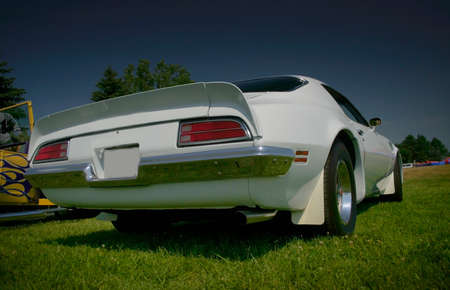 horsepower: White muscle car rear end -wide angle shot Stock Photo