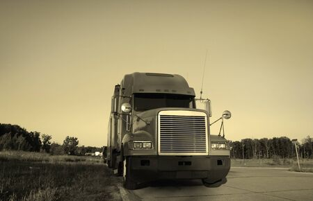 Semi truck with sky background in sepia color photo