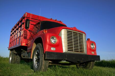 Red truck with blue sky background wide angle photo Stock Photo