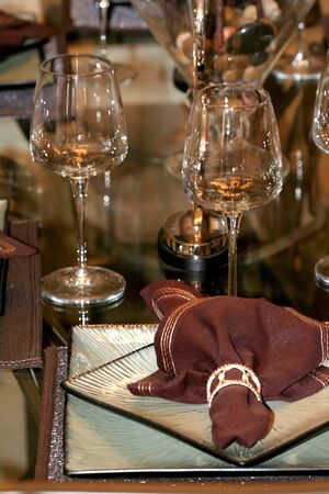 Wine glasses on the table with brown napkin photo