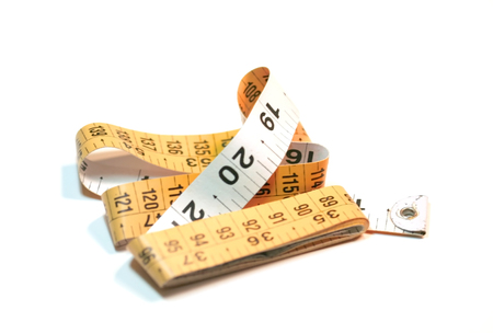 Isolated orange and white colored measuring tape Imagens - 1439956