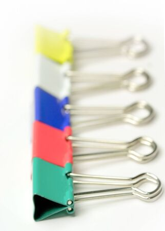 disorganize: paper clips in a row on a white background