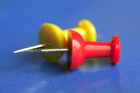 An abstract of red and yellow push pins Banco de Imagens