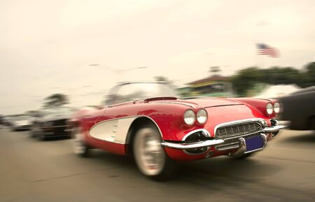 Cruising red sports car in sepia color tone