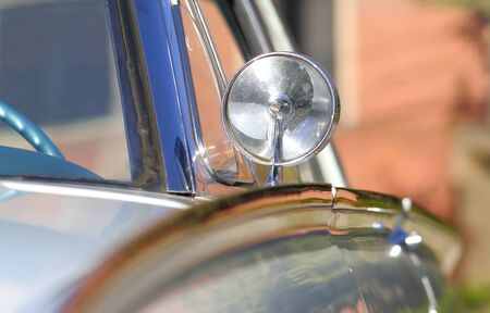 Close up shot of rear view mirror of vintage car