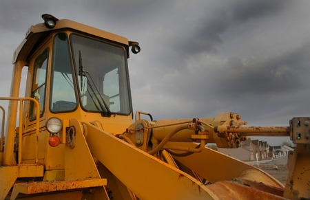 frontend: Construction equipment with blue sky background wide angle