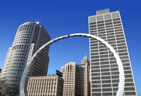 arch and sky scrapers in detroit down town
