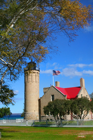 Historic Mackinac Light house with blue sky background photo