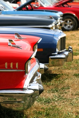 Muscle cars in a row at vintage car show