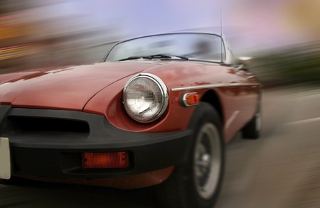 Old sports car in fast motion concept