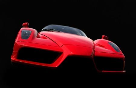 ferrari: Red Ferrari car isolated on black background