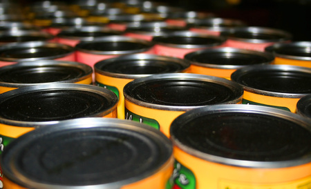 commerce and industry: Food cans in a row for donation to charity