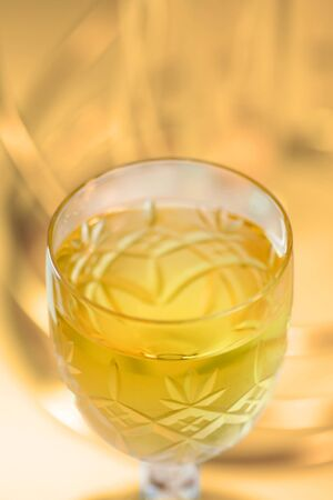 inebriated: Close up shot of wine glass with shallow depth of field