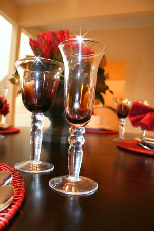 Bright sparkling wine glasses on dinning table photo