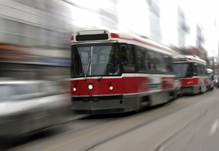 streetcar: street trams on toronto street in motion blur