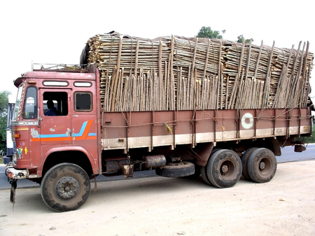 Truck Carrying Load Of Woods  photo