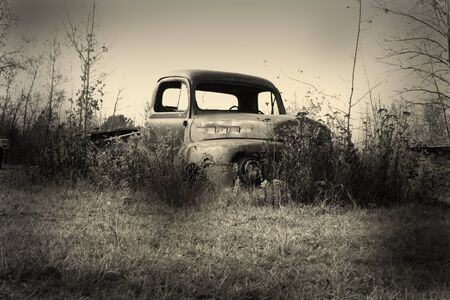 dumps: old pickup truck body in the junk yard Stock Photo